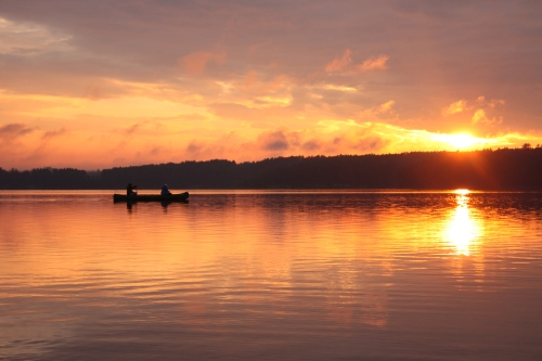 Dana and Weston paddling during sunset (Photo - Ryan Mallek)