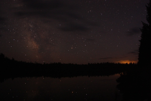 The milky way with lighting off in the distance (lower right corner in the clouds)