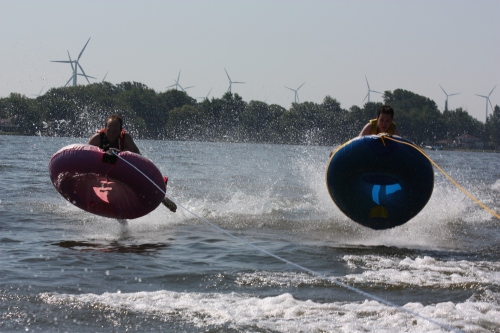 Aaron and Weston getting some extreme tubing hang time