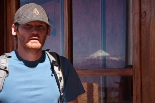 Ben in Quito with Cotopaxi in the window reflection