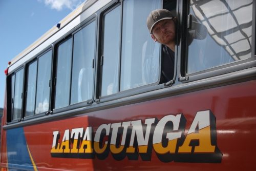 """Ben sticking his head out of the bus window above one of my favorite city names in the world """"Latacunga"""""""