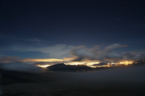 The lights of Quito reflected in the low clouds as seen from camp on Cotopaxi