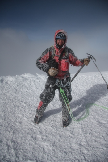 Weston celebrating on the summit of Cotopaxi