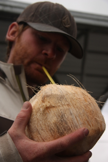 Ben sipping on a fresh cracked coconut