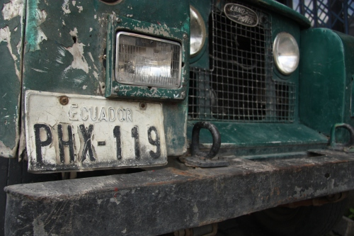 An old Land Rover that has seen better days on the streets of Banos Ecuador