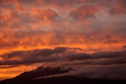Fiery sunset on Chimborazo as seen from Riobamba